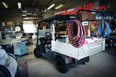 Hauler 1200 in Work Garage with Ladder Rack Rear View.jpg