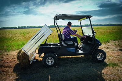 Hauler 1200X Side View in Field Dumping Hay.jpg